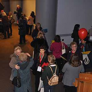 Participants gather and chat before the general session.