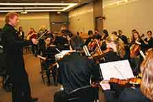 The friction-less collaboration of musicians in an orchestra was used to demonstrate teamwork.