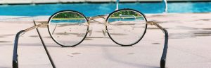 Eyeglasses by the pool